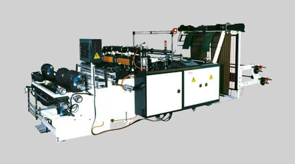 Economy T-shirt bag on roll making machine + Manual roll change system