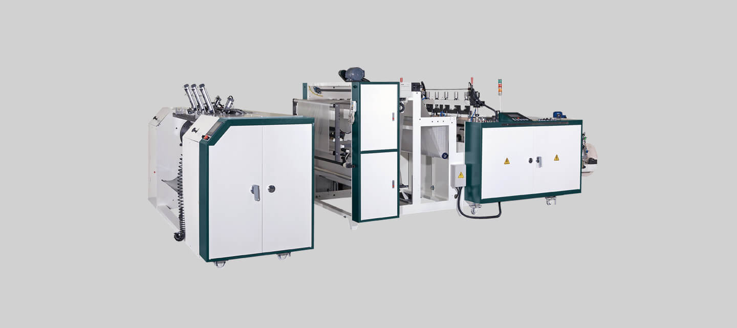 Fully automatic vegetable bag on roll making machine + heat-slitting system & Multi-line core change